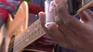 Guitar being played close up slow motion