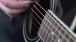 Guitar strings strummed in Slow motion