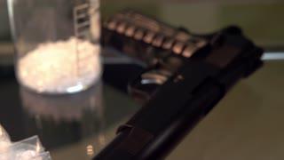 Gun and drugs in little baggies