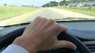Hand of driver on steering wheel slow motion