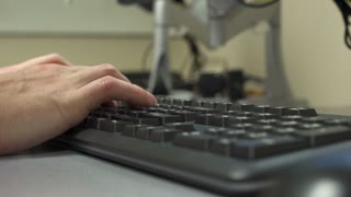 Hand of person typing at desktop computer keyboard 4k