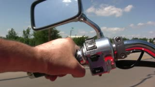 Hand View while riding Motorcycle