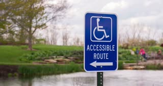 Handicap accessible route sign at park 4k.