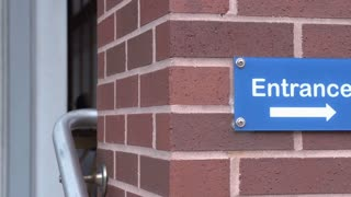 Handicap entrance sign pan shot