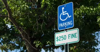 Handicap parking sign with violation fine posted 4k