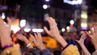 Hands in crowd cheering