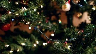 Hanging bulbs on Christmas tree