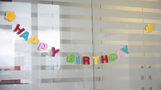 Happy Birthday message hanging in office 4k