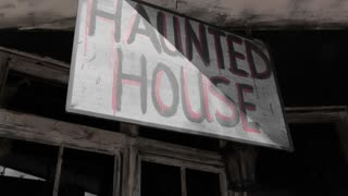 Haunted House sign by old building