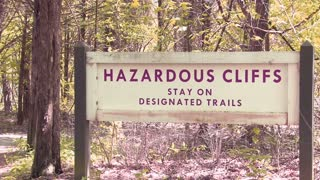 Hazardous Cliffs Sign in Forest
