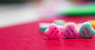 Heart candies with love messages written on them 4k