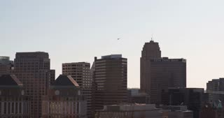 Helicopter flying over Downtown Cincinnati buildings 4k