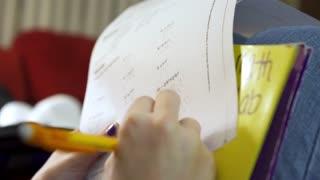 High school girl working on math homework 4k
