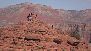 Hill of rocks at West Rim of Grand Canyon with people climbing to top 4k