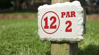 Hole twelve on mini golf sign