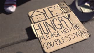 Homeless and Hungry sign on cardboard asking for money 4k