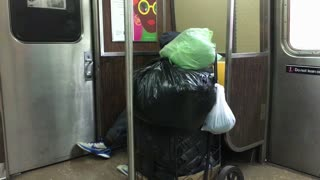Homeless man asleep on train in New York City 4k