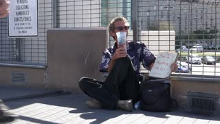 Homeless man in need with sign asking for anything 4k