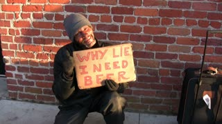 Homeless man with Beer Sign