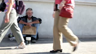 Homeless Man with sign asking for Money