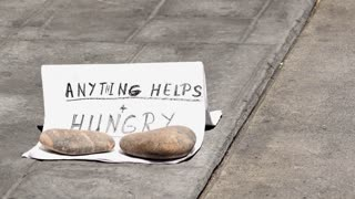 Homeless with anything helps and hungry sign on sidewalk 4k
