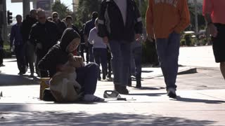 Homeless woman sitting with dog on streets of Las Vegas 4k