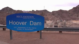 Hoover Dam reclamation sign with mountain in background 4k