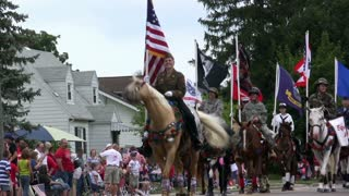 Horses with Flags in parade