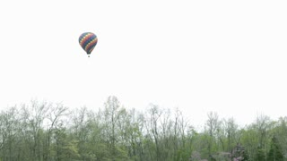 Hot air balloon above forest