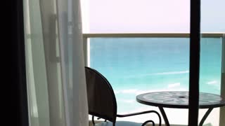 Hotel balcony with ocean waves in background