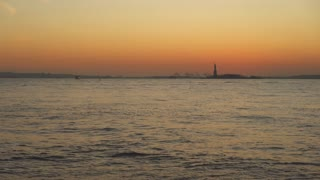 Hudson river with Statue of Liberty in background 4k