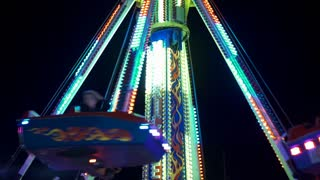 Hurricane carnival ride spinning passengers at Huber Heights festival 4k