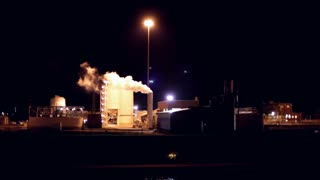 Industrial Plant smoking at night