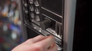 Inserting change into vending machine 4k