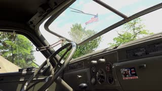 Inside cabin of military transport vehicle with American Flag in window 4k