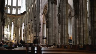 Inside of the Cologne Cathedral sitting at pew