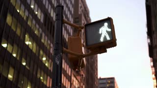Intersection crosswalk sign flashing in large city 4k
