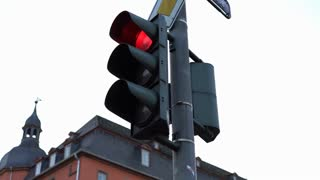 Intersection light changing from red to green pan shot 4k
