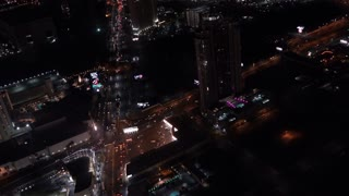Intersection traffic going down Las Vegas Boulevard at night