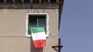Italian flag hanging out window