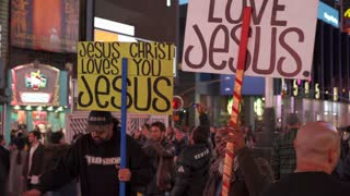 Jesus is Love sign in downtown Times Square New York 4k