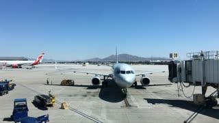 Jet bridge being attached to plane prior to deboarding 4k