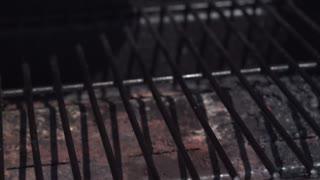Juicy steak hitting grill in slow motion