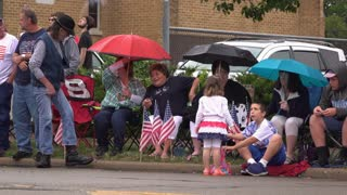 July 4th in small town of Fairborn Ohio people watching parade 4k
