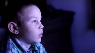 Kid watching TV late at night