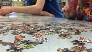 Kids building puzzle in library