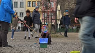 Kids playing in streets of Cologne with bubbles 4k