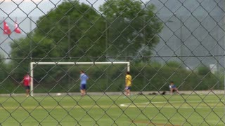 Kids practicing soccer focus on fence part 2