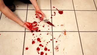 Knife and blood on kitchen floor