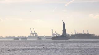 Lady Liberty with tourist boats surrounding Liberty Island 4k